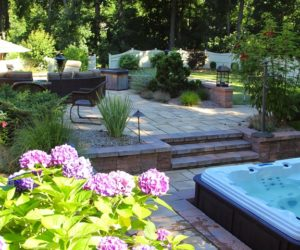 Backyard With A Stone Patio With A Hot Tub Grill And Seating, Stonework Wilbraham MA, Outdoor Living Design Western MA, Landscape Designer